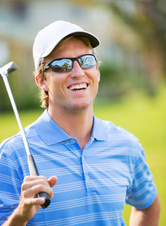 Athletic young man playing golf, Portrait of Golfer on Course with putter Stock fotó