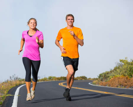 active lifestyle: Fitness sport couple jogging outside, training together outdoors. Running on road