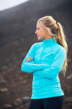 fitness goal: Young attractive athletic woman, wearing sporty cloths on trail