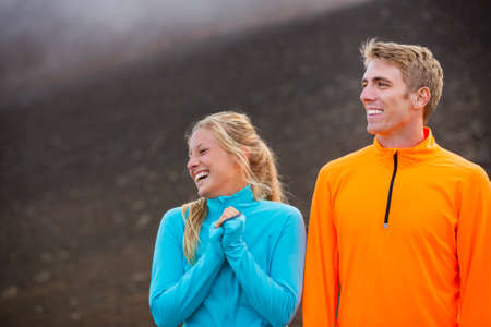 man working out: Young attractive athletic couple, wearing sporty cloths on trail