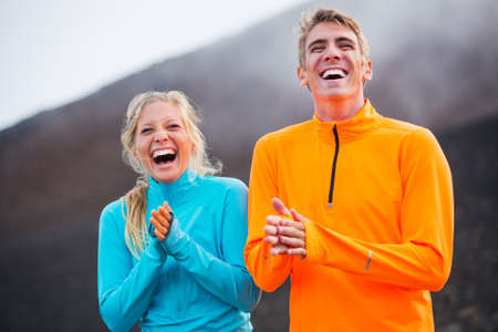 Young attractive athletic couple, wearing sporty cloths on trail photo