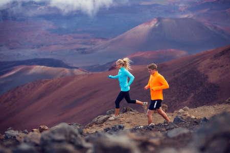 marathon running: Fitness sport couple running jogging outside on trail