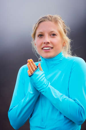 Young attractive athletic woman, wearing sporty cloths on trail outside in nature, relaxing after workout photo