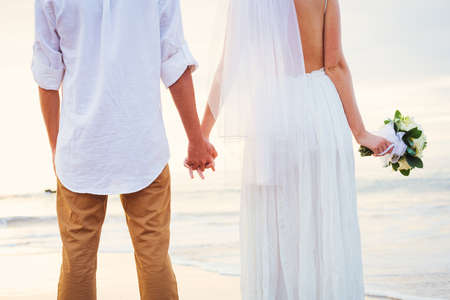Bride and Groom, Romantic Newly Married Couple Holding Hands, Just Married photo