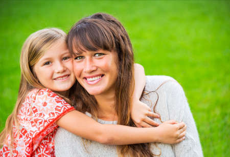 children playing together: Portrait of happy mother and daughter Stock Photo
