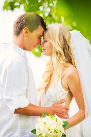 Bride and Groom, Romantic Newly Married Couple Embracing, Just Married photo