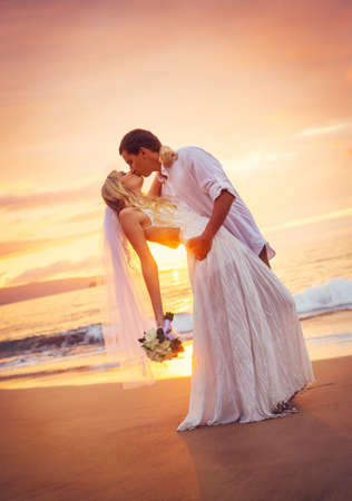 beach kiss: Bride and Groom, Kissing at Sunset on a Beautiful Tropical Beach, Romantic Married Couple