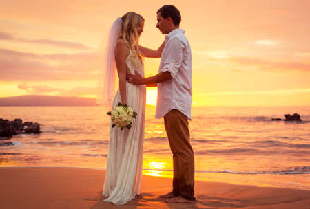 Just married couple on tropical beach at sunset, Hawaii Beach Wedding