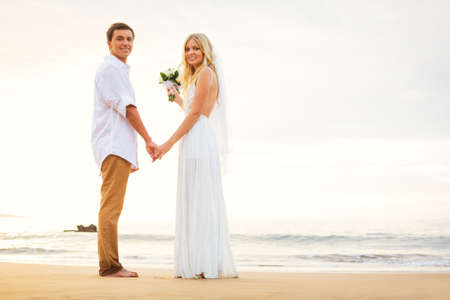 Just married couple holding hands on the beach, Hawaii Beach Wedding photo