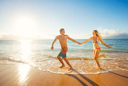 Happy Couple Running on Tropical Beach at Sunset, Vacation  photo