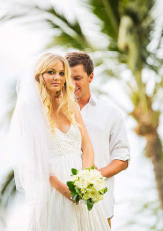 Married couple, bride and groom getting married, Tropical wedding in Hawaii photo