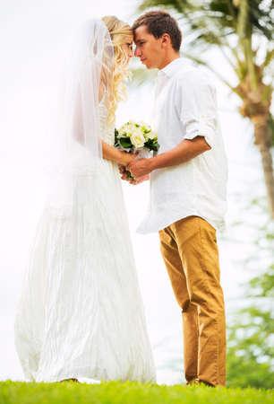 getting married: Married couple, bride and groom getting married, Tropical wedding in Hawaii