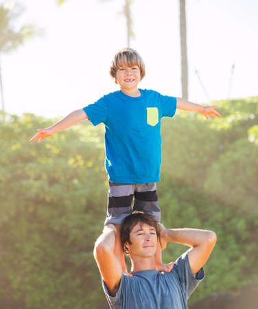 Happy father and son playing on tropical beach, carefree happy fun smiling lifestyle Reklamní fotografie - 25087748