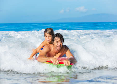 Father and Son Surfing Tandem Together Catching Ocean Wave photo
