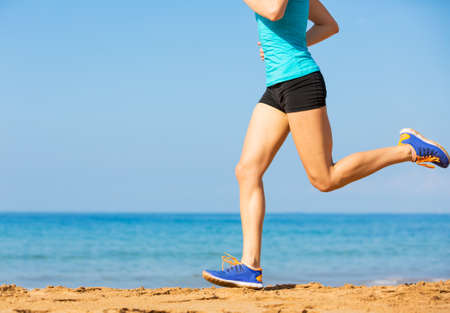 Woman running on beach, Exercise fitness concept Stock Photo