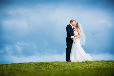 outdoor event: Wedding Couple, Bride and Groom Kissing Stock Photo