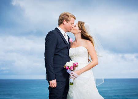 Wedding Couple, Bride and Groom Kissing photo