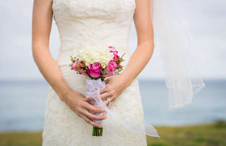 Beautiful bride with bouquet of flowers photo