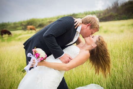 Wedding Couple, Happy romantic bride and groom kissing photo