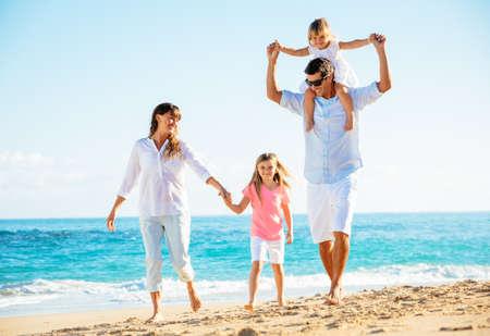 latin family: Family having fun on the beach Stock Photo