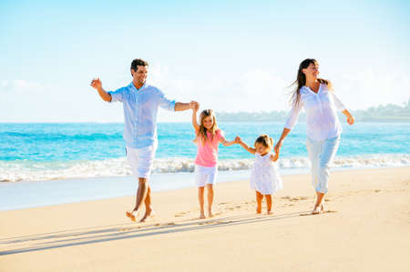 latin people: Family having fun on the beach Stock Photo