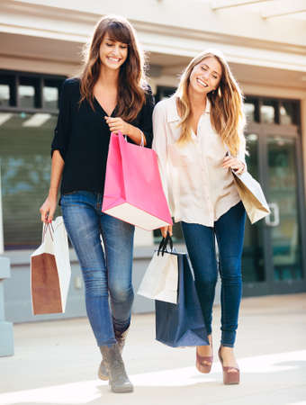 Two happy young women shopping at the mall Stock Photo - 26326810