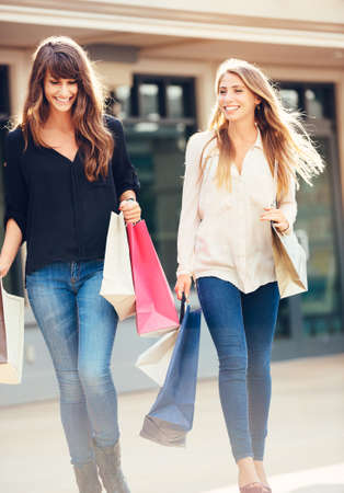 Two happy young women shopping at the mall Stock Photo - 26326414