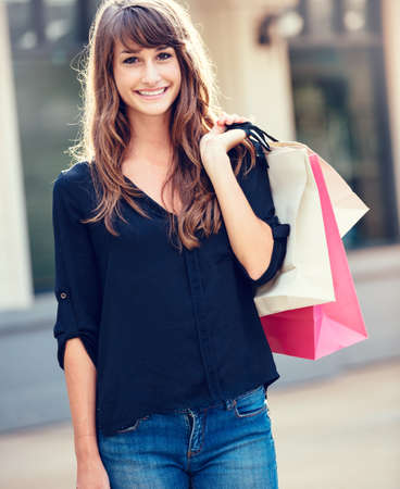 Attractive happy young woman shopping at the mall Stock Photo - 26326815