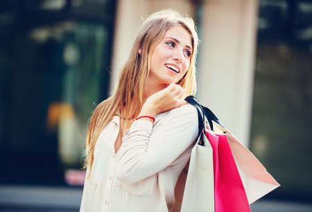 Attractive happy young woman shopping at the mall photo