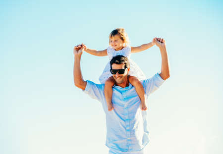 father daughter: Father and Daughter Having Fun at the Beach Stock Photo