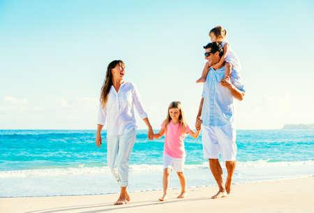 family walking: Happy Family Having Fun Walking on Tropical Beach