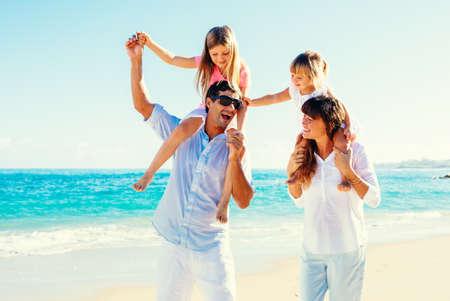 family beach: Happy Family Having Fun on Tropical Beach Stock Photo