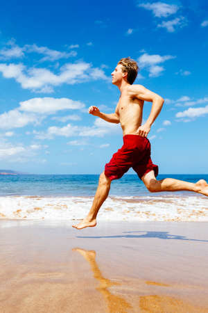 Athletic Man Running on Beach photo