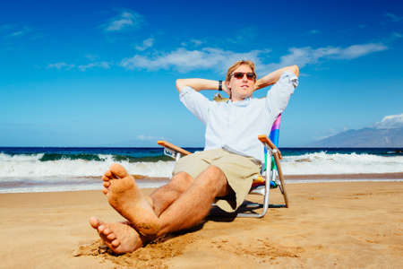 Young Successful Entrepreneur Businessman Relaxing on the Beach photo