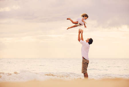 father and daughter: Healthy Father and Daughter Playing Together at the Beach at Sunset. Happy Fun Smiling Lifestyle