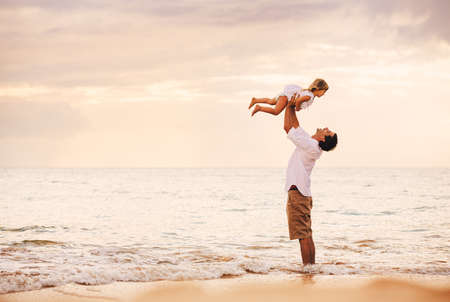 little girl beach: Healthy Father and Daughter Playing Together at the Beach at Sunset. Happy Fun Smiling Lifestyle