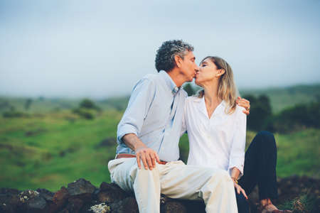 Happy loving middle aged couple kissing photo
