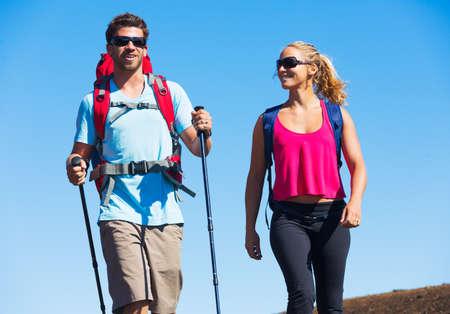 Hikers enjoying walk on amazing mountain trail. Backpacking in Haleakala volcano, incredible view. Couple trekking.  免版税图像