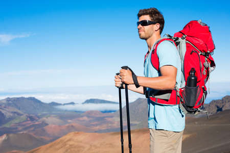 Hiker with backpack in the mountains