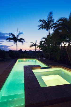 pool deck: Luxury Home with Pool and Hot Tub at Sunset