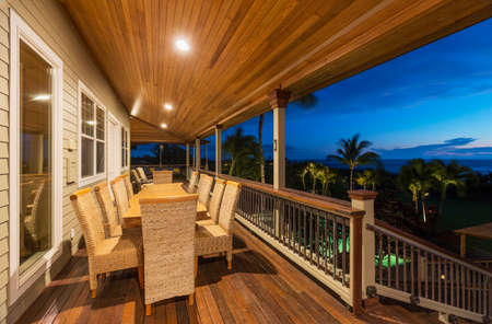 Beautiful Home Exterior Patio Deck and Dining Table with Sunset View photo