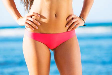 wet bikini: Woman with a beautiful bikini body on tropical beach