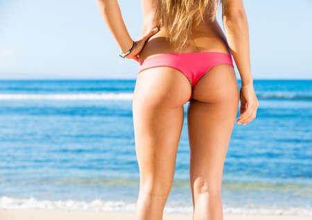 Sexy back of a beautiful woman on tropical beach in small sexy bikini  photo