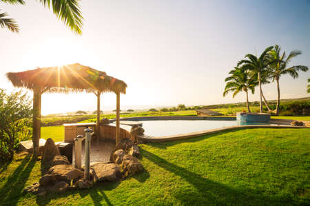 forsale: Luxury home, green lawn with swimming pool Stock Photo