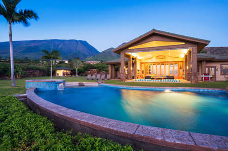 home garden: Luxury home with swimming pool at sunset