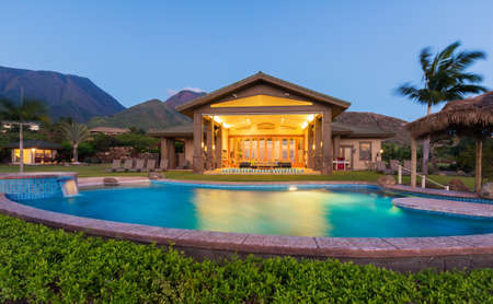 Luxury home with swimming pool at sunset photo