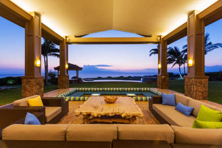 home exterior: Beautiful Luxury Home, Exterior Patio Lounge at Sunset Stock Photo