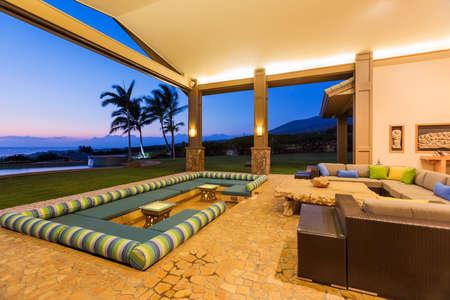 lounge: Beautiful Luxury Home, Exterior Patio Lounge at Sunset Stock Photo