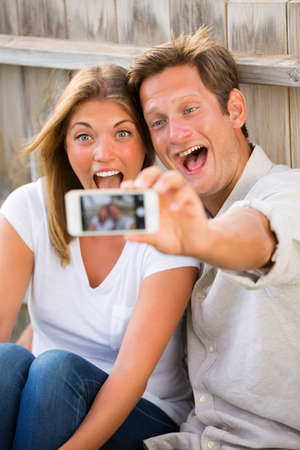 Happy young couple taking a selfie with smart phone Фото со стока - 28873065
