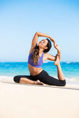 adult mermaid: Beautiful young woman in yoga pose at the beach. Morning zen mediation outdoors. Practicing yoga. Healthy Active Lifestyle Concept.